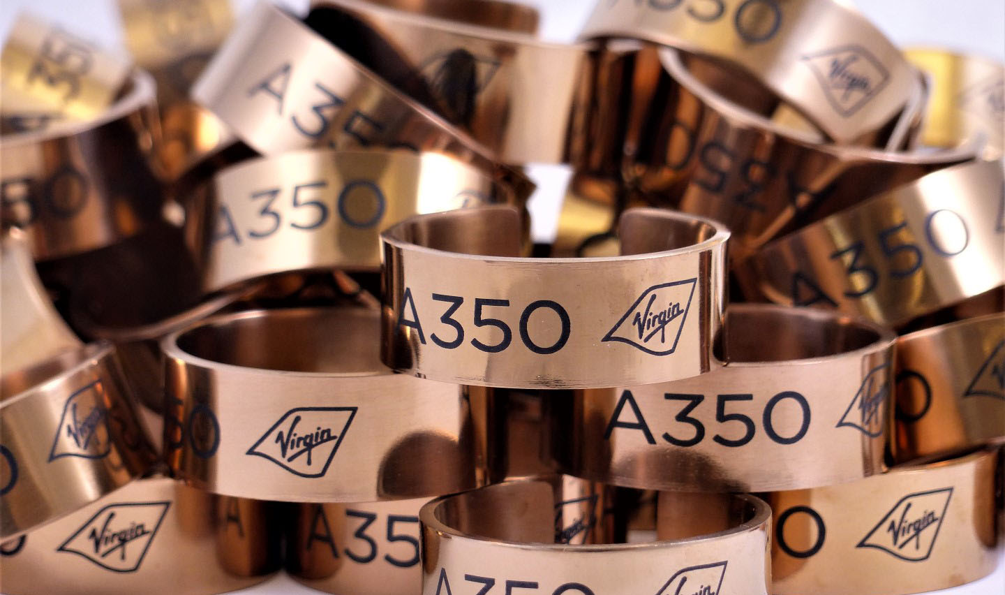 Laser marked metal napkin rings with a black ceramic compound.