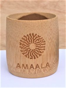 Logo and text raster engraved onto bamboo cup.