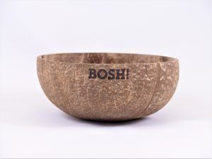 Laser raster engraved coconut shell with text.