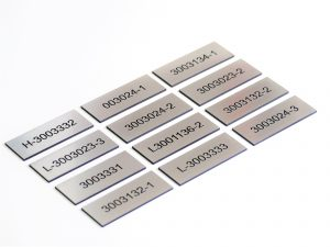 Stainless steel marked machine tags by a ceramic paste leaving crisp black text.